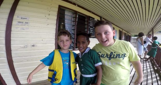 Andrea and Mattia with a friend, Ratu Namasi Memorial School, Yasawa Island, Fiji. Author and Copyright Marco Ramerini