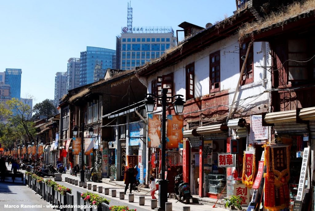 Still corners of old Kunming coexist flanked by modern neighborhoods, Kunming, Yunnan, China. Author and Copyright Marco Ramerini