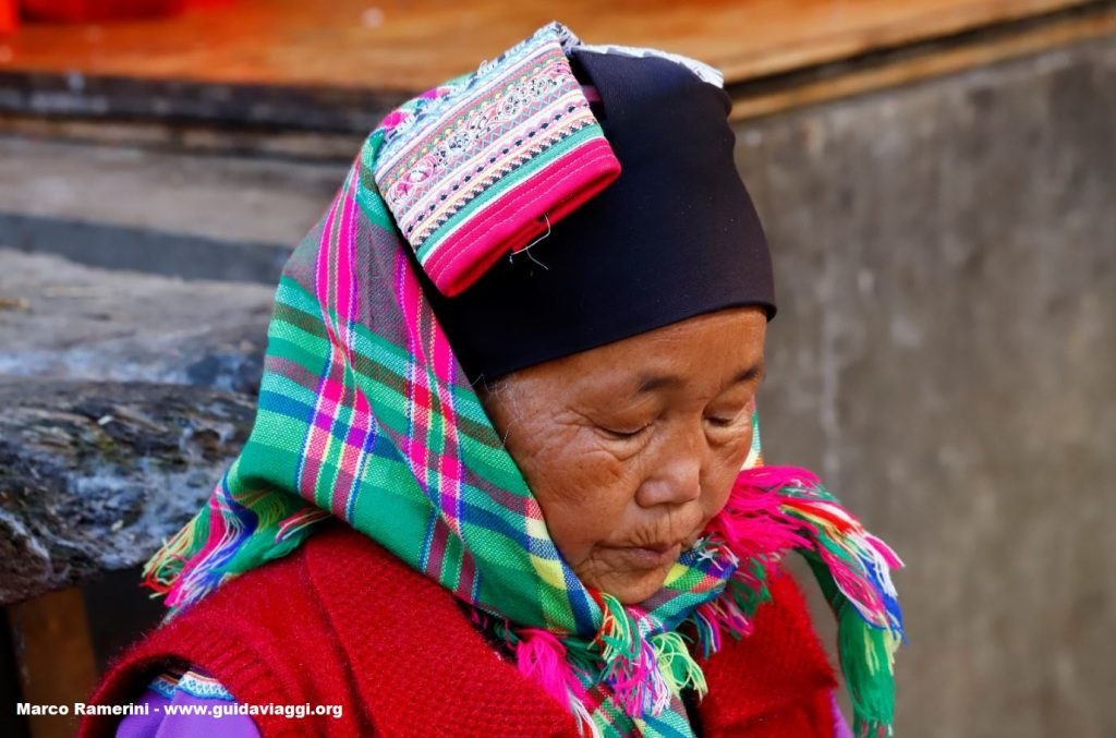 Woman, Zhoucheng, Yunnan, China. Author and Copyright Marco Ramerini ,.