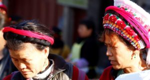 Women at the market in Zhoucheng, Yunnan, China. Author and Copyright Marco Ramerini