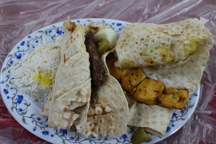 Lamb and chicken kabab with bread and rice. Author and Copyright Marco Ramerini