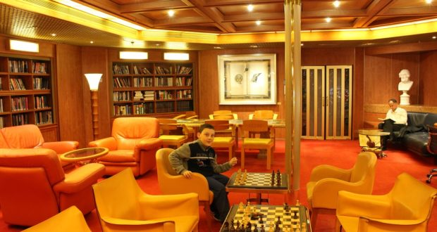 Andrea in the ship's library. Author and Copyright Marco Ramerini